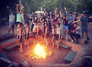 Aboriginal children and students by the campfire