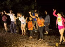 Children practicing aboriginal dance at night