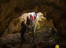 Students walking down a cave stairs