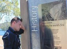 A boy staring at a wall with 'History' on it